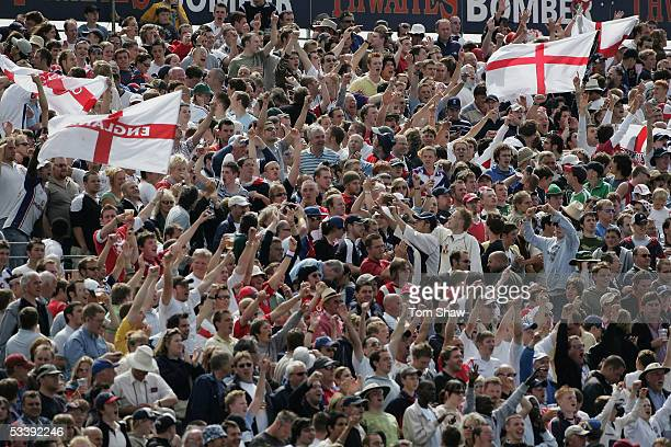 England fans watch on during day five of the Third npower Ashes Test match between England and Australia at Old Trafford on August 15 2005 in...