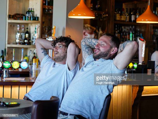 England fans watch the game in the Five Degrees West pub on June 13, 2021 in Falmouth, England. Due to the good weather and a few new cases of...