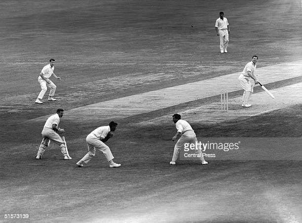 England fast bowler Fred Trueman taking his 300th test wicket after Neil Hawke is caught by Colin Cowdrey at slip during the fifth test match against...