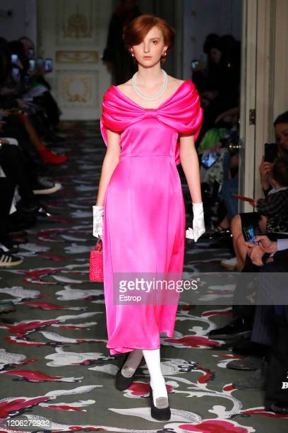 A model walks the runway at the Shrimps show during London Fashion Week February 2020 at the BFC Courtyard Showspace on February 14 2020 in London...