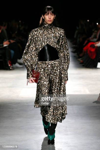 England – February 17: A model walks the runway at the Christopher Kane show during London Fashion Week at the The Mail Centre February 2020 on...