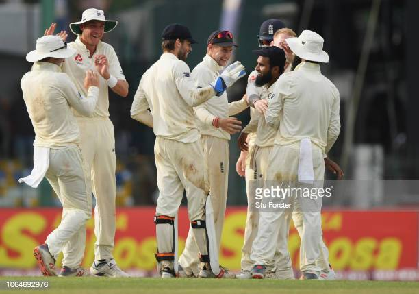 England fielder Adil Rashid celebrates with team mates after running out Sri Lanka batsman Rangika during Day Two of the Third Test match between Sri...