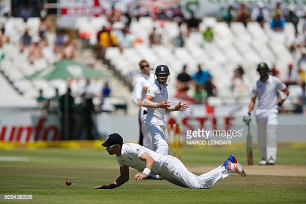 England fielder Alastair Cook dives to catch a ball during day four of the second Test match between South Africa and England at Newlands Stadium in...