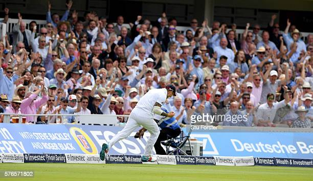 England fielder Alex Hales takes a catch to dismiss Pakistan batsman MisbahulHaq as the Lords crowd celebrate during day three of the 1st Investec...
