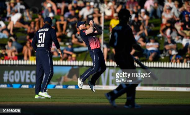 England fielder Ben Stokes catches out Martin Gutill during the 1st ODI between New Zealand and England at Seddon Park on February 25 2018 in...