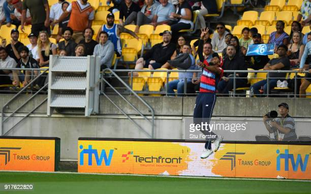 England fielder Chris Jordan jumps high to take a catch on the boundary edge to dismiss New Zealand batsman Colin de Grandhome during the...