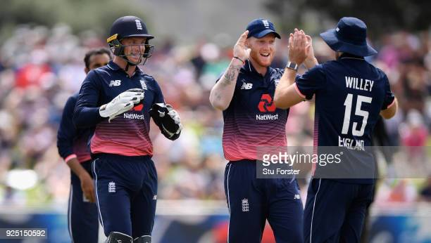 England fielder David Willey is congratulated by Jos Buttler and Ben Stokes after running out Ross Taylor during the 2nd ODI between New Zealand and...