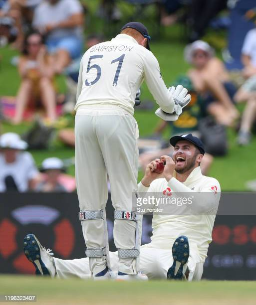 England fielder Dom Sibley celebrates with Jonny Bairstow after he had caught out South Africa batsman Dwaine Pretorius during Day Three of the First...