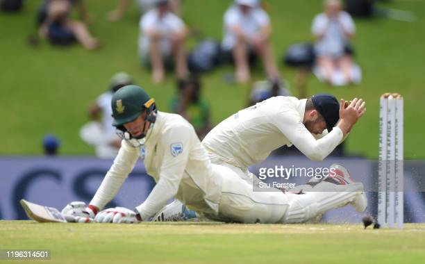 England fielder Dom Sibley reacts after narrowly running out South Africa batsman Rassie van der Dussen during Day Three of the First Test match...