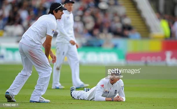 England fielder Graeme Swann looks up at Alastair Cook after he had dropped a catch off Chris Rogers during day two of 4th Investec Ashes Test match...