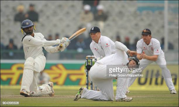 England fielder Ian Bell ducks to avoid a shot from Indian batsman Harbhajan Singh during the 2nd Test match between India and England at the Punjab...