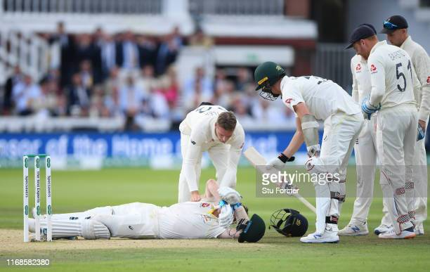 England fielder Jos Buttler rushes to the aid of Australia batsman Steve Smith after he is hit on the helmet by a ball from Jofra Archer during day...