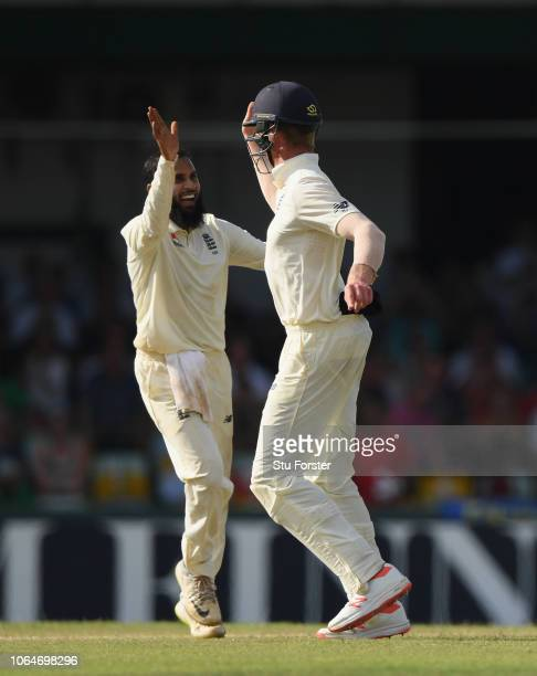 England fielder Keaton Jennings celebrates with bowler Adil Rashid after they combined to dismiss Roshen Silva during Day Two of the Third Test match...