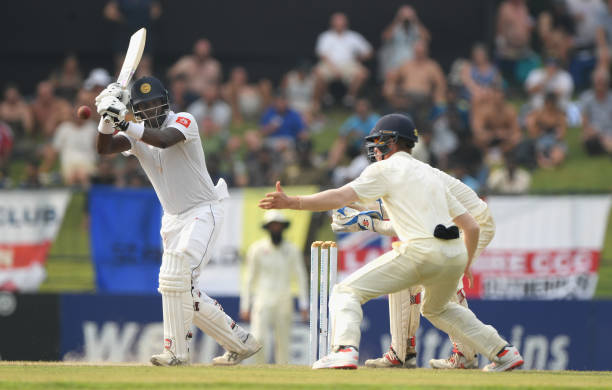 England fielder Keaton Jennings reacts as Sri Lanka batsman Angelo Matthews hits out during Day Four of the Second Test match between Sri Lanka and...