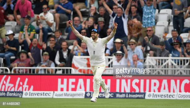 England fielder Mark Wwood celebrates after taking the catch to dismiss Hashim Alma during day one of the 2nd Investec Test match between England and...