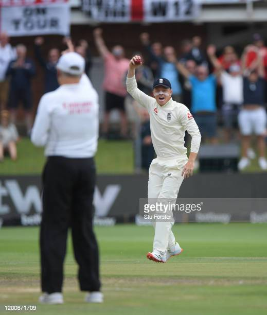 England fielder Ollie Pope celebrates after catching out Vernon Philander off the bowling of Stuart Broad during Day Five of the Third Test between...