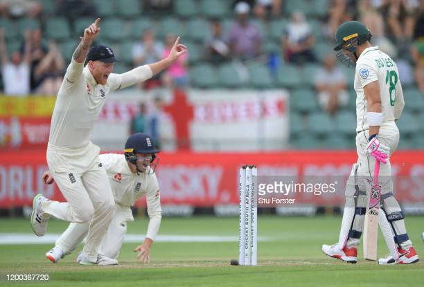 England fielder Ollie Pope celebrates with Ben Stokes after catching out Faf du Plessis off the bowling of Dom Bess during Day Three of the Third...