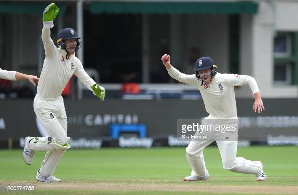 England fielder Ollie Pope celebrates with Jos Buttler after catching out Dean Elgar off the bowling of Dom Bess during Day Three of the Third Test...