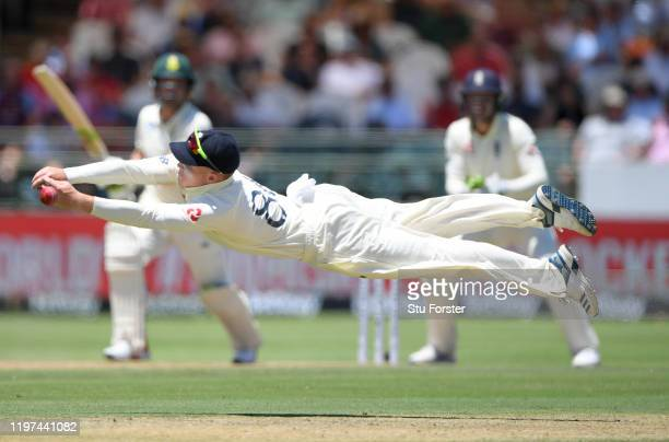 England fielder Ollie Pope dives in vain to cling onto a chance off Dean Elgar off the bowling of Dominic Bess during Day Two of the Second Test...