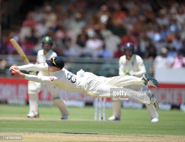 England fielder Ollie Pope dives in vain to cling onto a chance off South Africa batsman Dean Elgar off the bowling of Dominic Bess during Day Two of...