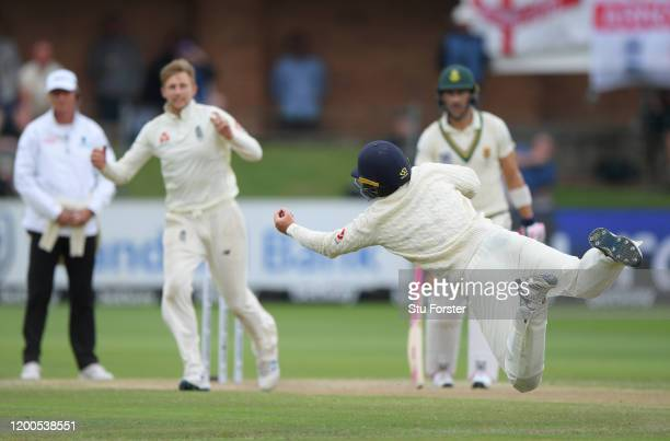 England fielder Ollie Pope dives to catch South Africa batsman Rassie van der Dussen off the bowling of Joe Root during Day Four of the Third Test...