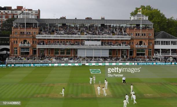 England fielder Ollie Pope runs out India batsman Cheteshwar Pujara during day two of the 2nd Specsavers Test Match between England and India at...