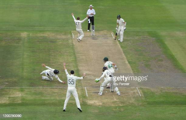 England fielder Ollie Pope takes the catch to dismiss Dean Elgar off the bowling of Dom Bess during Day Three of the Third Test between England and...
