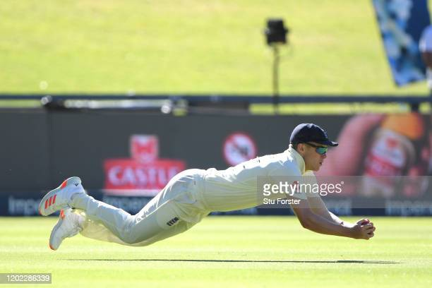England fielder Sam Curran takes the catch to dismiss South Africa batsman Dwaine Pretorius during Day Four of the Fourth Test between South Africa...
