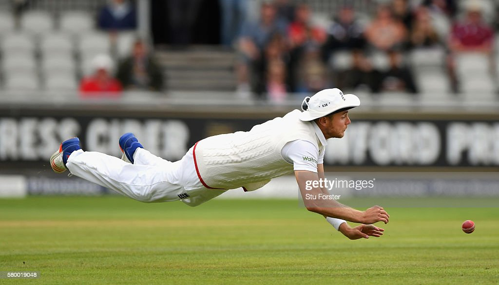 England fielder Stuart broad goes airbourne in an attempt to run out Pakistan batsman Wasib Riaz during day four of the 2nd Investec Test match between England and Pakistan at Old Trafford on July 25, 2016 in Manchester, England.