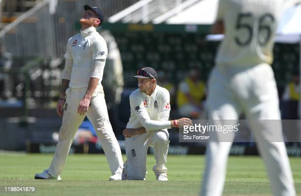 England fielders Ben Stokes and Joe Root react after a chance just falls short during Day Five of the Second Test between South Africa and England at...