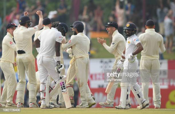 England fielders celebrate the review decision as Sri Lanka batsman Angelo Matthews reacts after being given out during Day Four of the Second Test...