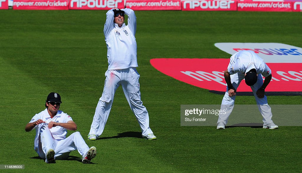 England fielders from left Alastair Cook; Graeme Swann and Andrew Strauss react after a near miss during day two of the 1st npower test match between England and Sri Lanka at the Swalec Stadium on May 27, 2011 in Cardiff, Wales.