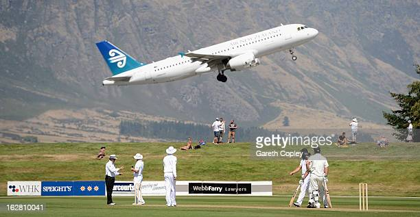 England fielders watch on a Air Zealand plane flys overhead during day two of the International tour match between the New Zealand XI and England at...
