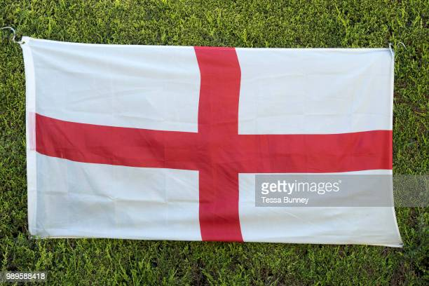 England flag hanging on a hedge to celebrate the 2018 World Cup in the village of Topcliffe North Yorkshire United Kingdom on 20 June 2018