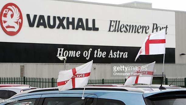 England flags fly from the workers cars as they leave Vauxhall Motor Company's Astra production centre at the end of their shift on May 17 2006 in...