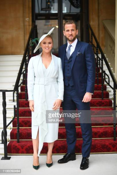 England football captain and Tottenham Hotspur player Harry Kane with his partner Kate Goodland arrive for his investiture ceremony at Buckingham...