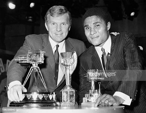 England football captain Bobby Moore and Portuguese footballer Eusebio at the BBC Television Theatre London with their trophies at the BBC Sports...