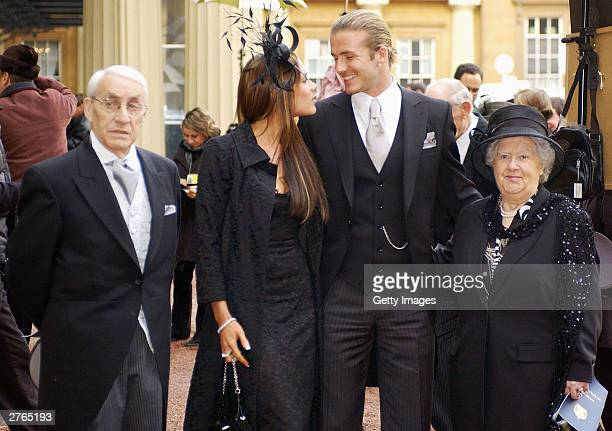 DAYS England football captain David Beckham with his wife Victoria and his maternal grandparents Joseph and Peggy West meet the press after he...