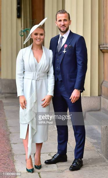 England football captain Harry Kane with his partner Kate Goodland after being made an MBE by the Duke of Cambridge at an investiture ceremony at...