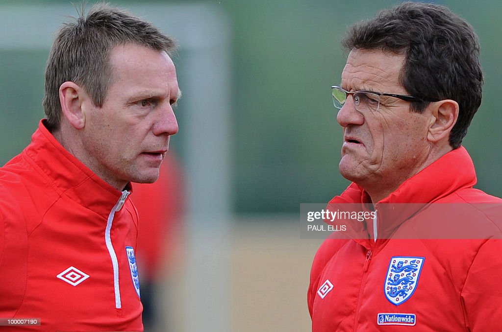 England football coach Fabio Capello (R) and his assistant Stuart Pearce attend a team training session in Irdning, Austria on May 19, 2010 ahead of the World Cup Finals in South Africa.