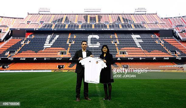 England football coach Gary Neville poses with a tshirt beside Club chairwoman Lay Hoon Chan during his official presentation as Valencia's new coach...