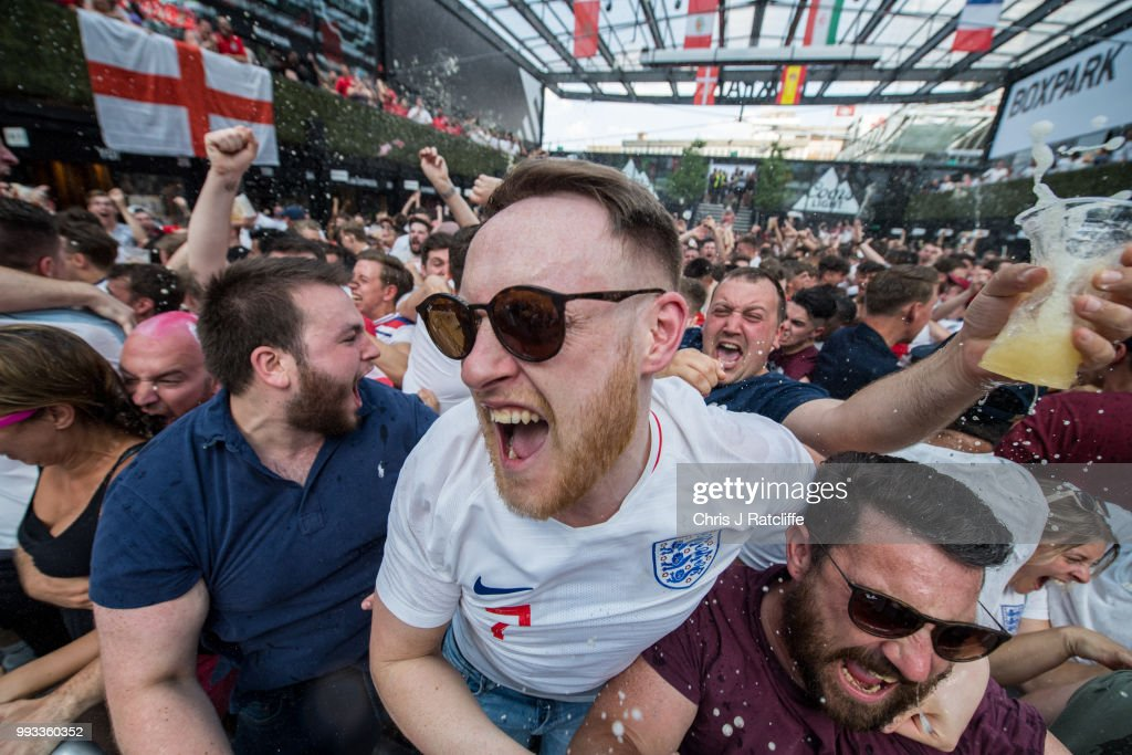 England football fans celebrate after England scored the first goal in the England V Sweden quater final match in the FIFA 2018 World Cup Finals at Croydon Boxpark on July 7, 2018 in London, England. World Cup fever is building among England fans after reaching the quater finals in Russia.