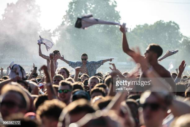 England football fans celebrate England's first goal during a Hyde Park screening of the FIFA 2018 World Cup semifinal match between Croatia and...