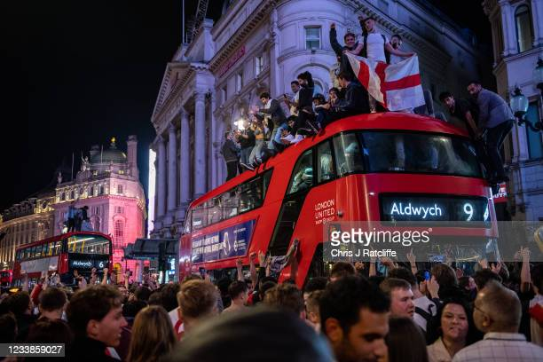 England football fans celebrate in the streets surrounding Piccadilly and Leicester Square after England beat Denmark in their semi final game on...