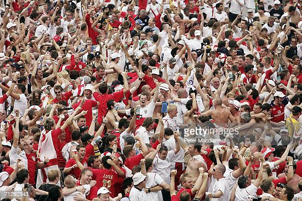 England football fans celebrate their team's goal against Ecuador on June 25 2006 in central Stuttgart Germany