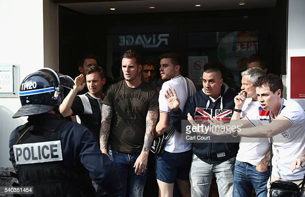 England football fans clash with police on June 15 2016 in Lille France Football fans from around Europe have descended on France for the UEFA Euro...