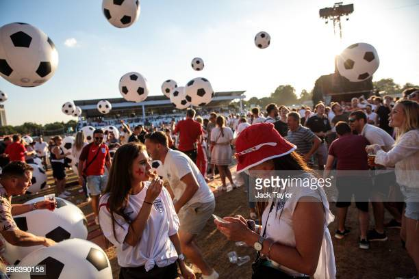England football fans kick inflatable balls during half time of the Hyde Park screening of the FIFA 2018 World Cup semifinal match between Croatia...