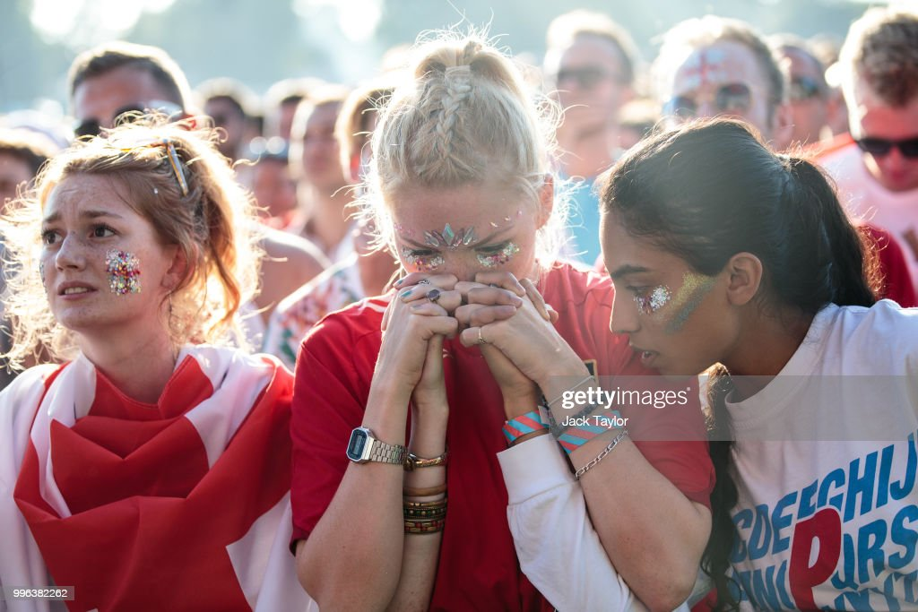 England football fans look on during a Hyde Park screening of the FIFA 2018 World Cup semi-final match between Croatia and England on July 11, 2018 in London, United Kingdom.The winner of this evening's match will go on to play France in Sunday's World Cup final in Moscow. Up to 30,000 free tickets were available by ballot for the biggest London screening of a football match since 1996.