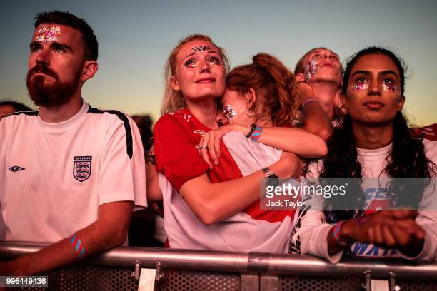 England football fans react after their defeat as they watch the Hyde Park screening of the FIFA 2018 World Cup semifinal match between Croatia and...