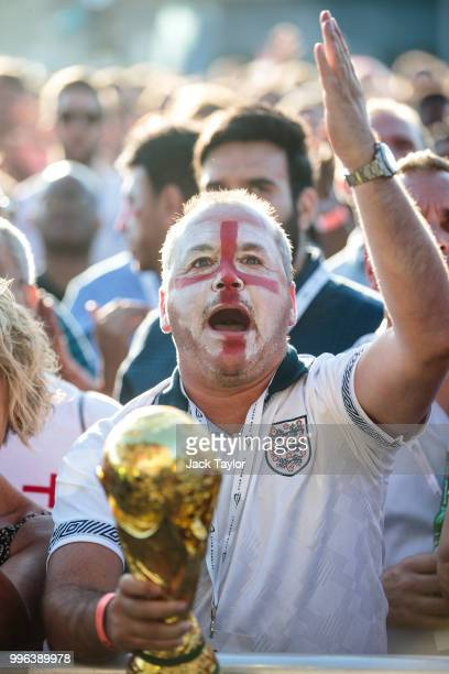 England football fans react as they watch the Hyde Park screening of the FIFA 2018 World Cup semifinal match between Croatia and England on July 11...